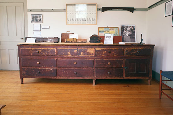 Photo of exhibit featuring the large tailoring counter