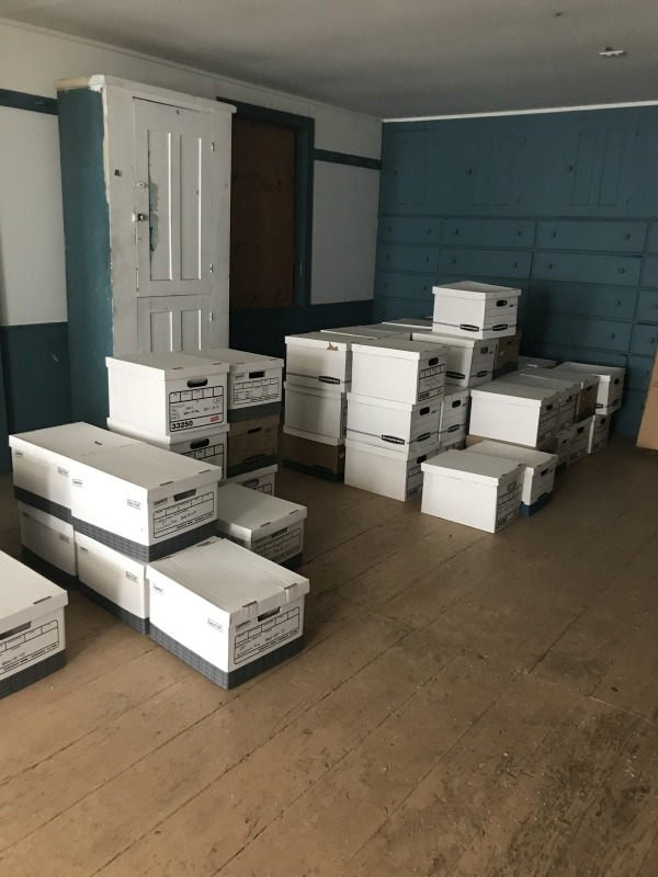 Boxes of archaeological artifacts patiently await their new home. Enfield Shaker preservation.