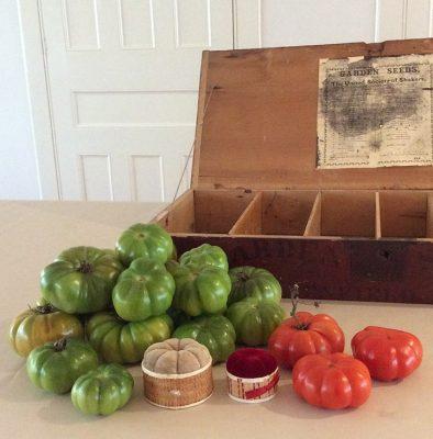 Large red tomatoes, poplarware pincushions, Enfield seedbox