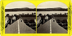 Stereoview at Enfield, NH Shaker Village - Looking east, Laundry, Hospital, Dentist Shop, Garden, and Lake in the foreground.