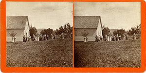 Stereoview of Enfield, NH Shaker Village - South Family schoolhouse with Shakers singing.