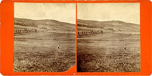 Stereoview of Enfield, NH Shaker Village - Nelson Chase stands in the field between South and Church Family.