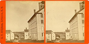 Stereoview of Enfield, NH Shaker Village - Looking east down the lane between the Wood House (left) and the Great Stone Dwelling (right).