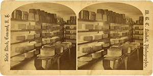 Stereoview of Canterbury, NH Shaker Village - Cheese Room with Cheeses and Turn-Table.